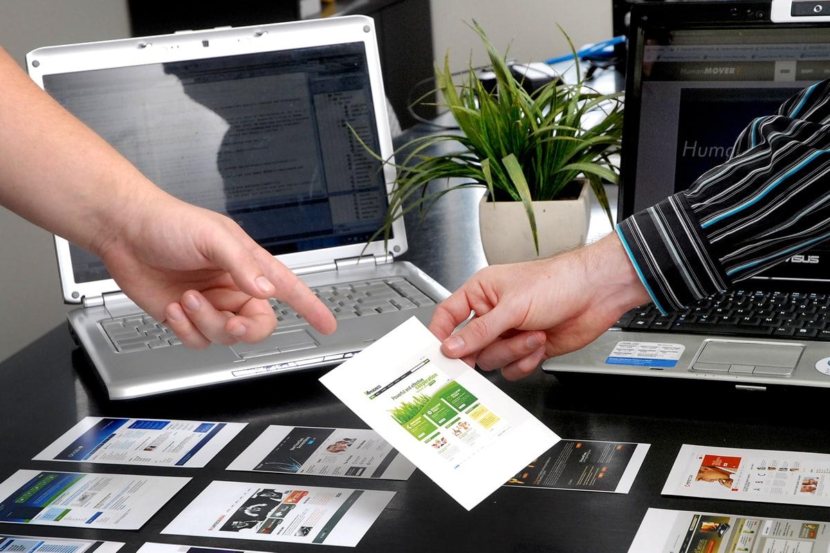 2 Business Men Choosing Photos for Website